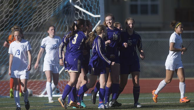 Fort Collins High School celebrates a goal from MJ Winey during a game against Poudre at French Field on Thursday.
