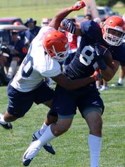 UTEP sophomore tight end Josh Weeks, right, tries to brush off freshman defensive back Deaumonjae Banks.