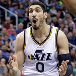 In this Jan. 26, 2015, file photo, Utah Jazz center Enes Kanter (0) shoots as Boston Celtics forward Brandon Bass (30) defends during an NBA basketball game, in Salt Lake City. A person familiar with the situation says the Jazz have traded  Kanter to the Oklahoma City Thunder for fellow center Kendrick Perkins. The person spoke Thursday, Feb. 19, 2015, on condition of anonymity because the teams had not announced the move. There likely will be more players and draft picks involved when the trade is finalized.