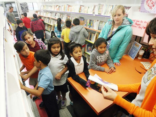 Big Rig Books visited Bonita Elementary School on Wednesday. More than 100 students received free books from John Gervase and his wife, Kathy, who operate Big Rig Books.