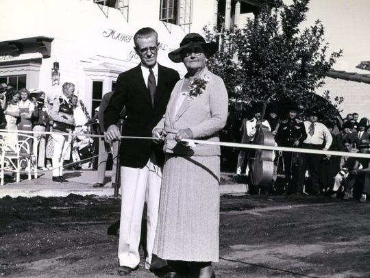 Nellie Coffman and Harry Williams cutting the ribbon