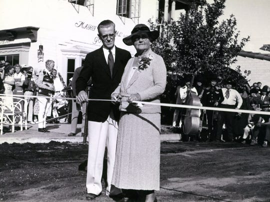 Nellie Coffman and Harry Williams cutting the ribbon on opening day.