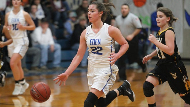 Eden High School's Emily Bunger (22) brings the ball down the court as Menard's Haleigh Cutrer gives chase during a District 16-1A girls basketball game at the Eden gym on Tuesday, Jan. 16, 2018.