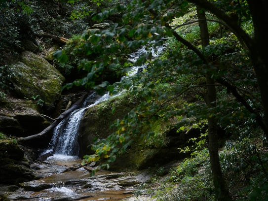 Water cascades down the rocks next to the Mason-Dixon