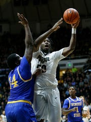 Caleb Swanigan puts up a shot over Howard Thomas of