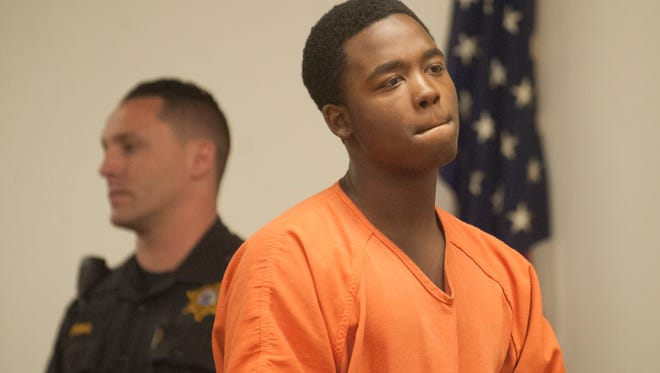 Ashan Thomas looks on during his arraignment for his role in the May 18 slaying of 19-year-old Terron L. Phillips of Camden.
