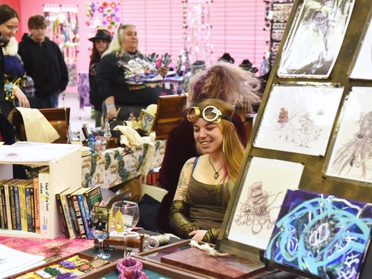 "Jessica Haga of Staunton mans a vendor table at SciFiCon 2014 held at the Staunton Mall on Saturday, Dec. 13, 2014. Event organizer Charles McFaddin Jr., aka ""The Commodore,"" states SciFiCon 2014 was a test run for a larger version of the event they hope to hold in a larger location this coming spring."