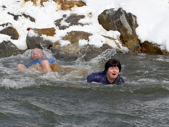Pastor Randall Black slips under the water as News