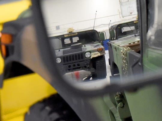 One of several Humvees is reflected in the side-view