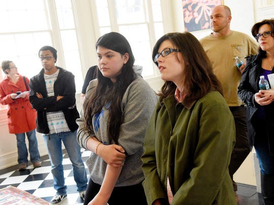 Reflected in a mirror, Sweet Briar College students Reiko Regan and Victoria Daniels listen to their guide while touring Mary Baldwin College in Staunton on Wednesday, March 11, 2015.