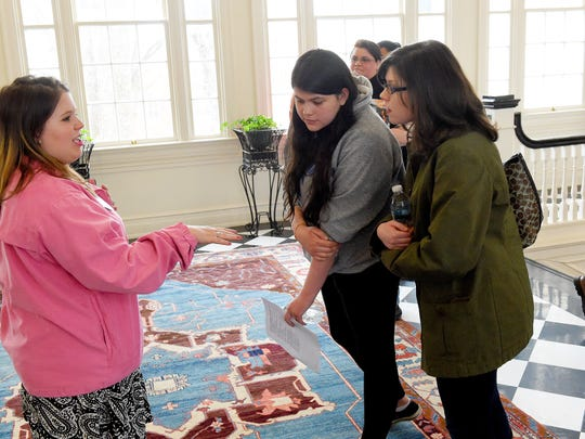Sweet Briar College students Reiko Regan and Victoria Daniels take a look at senior Amanda Johnson's class ring. Johnson gives the pair a tour of Mary Baldwin College in Staunton on Wednesday, March 11, 2015.