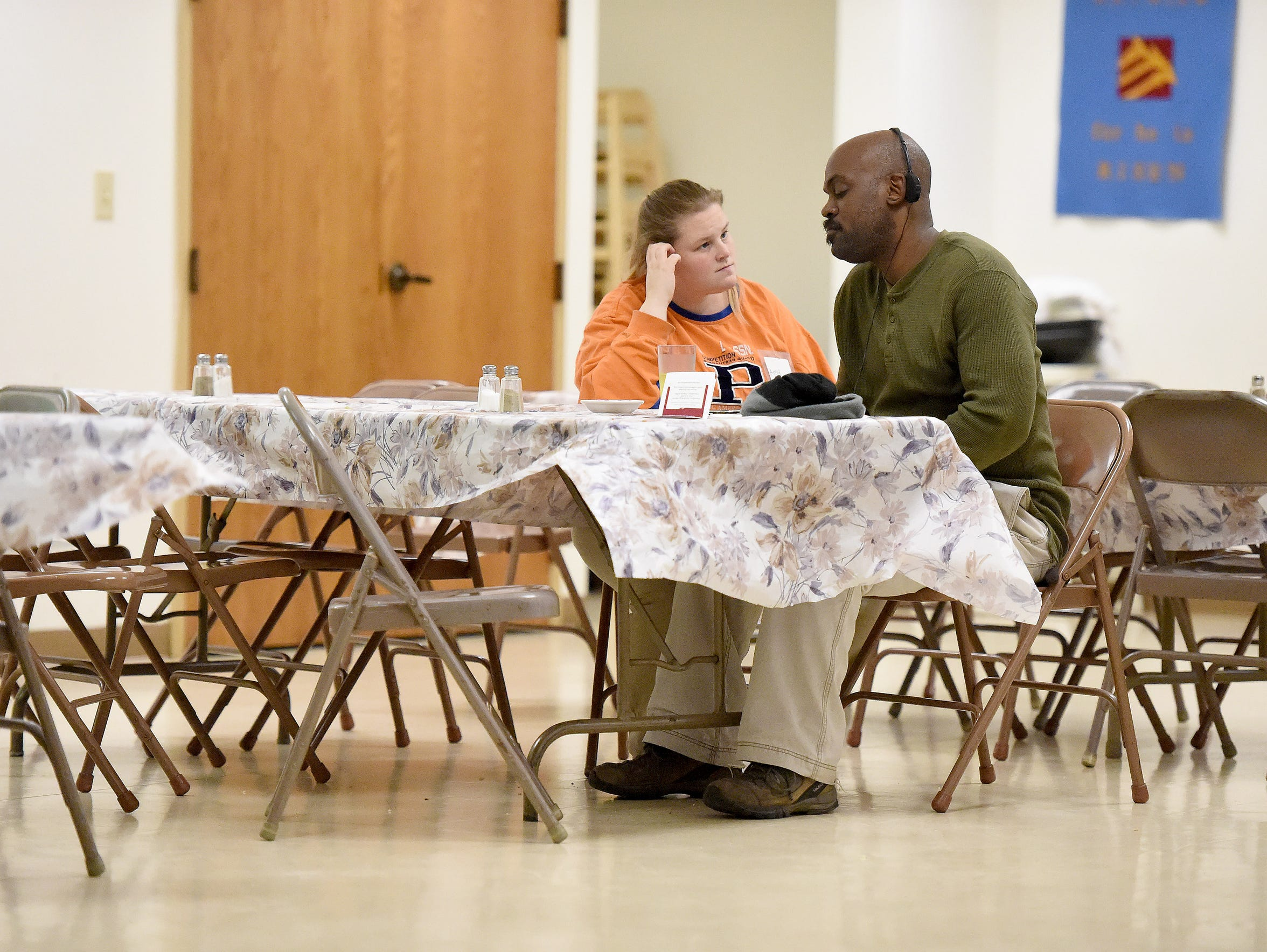 Currently homeless, Amy Roberts sits with her boyfriend,
