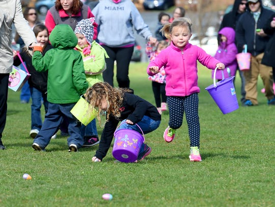 Egg hunters race across one of the soccer fields in