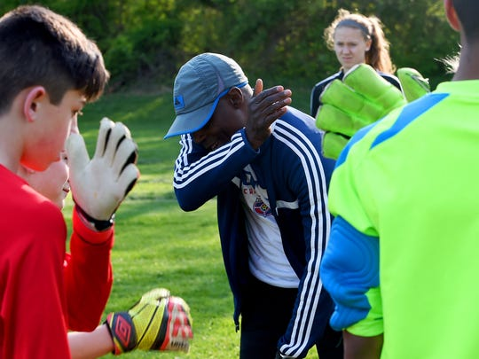 Sully Hamid, former professional soccer player, tells participants to give themselves a good pat on the back. He works with young soccer players during a goal keeper's clinic for SOCA players at Ridgeview Park on Wednesday, April 22, 2015. Hamid played seven years of professional soccer with the Queenspark Rangers of the English Premier League.