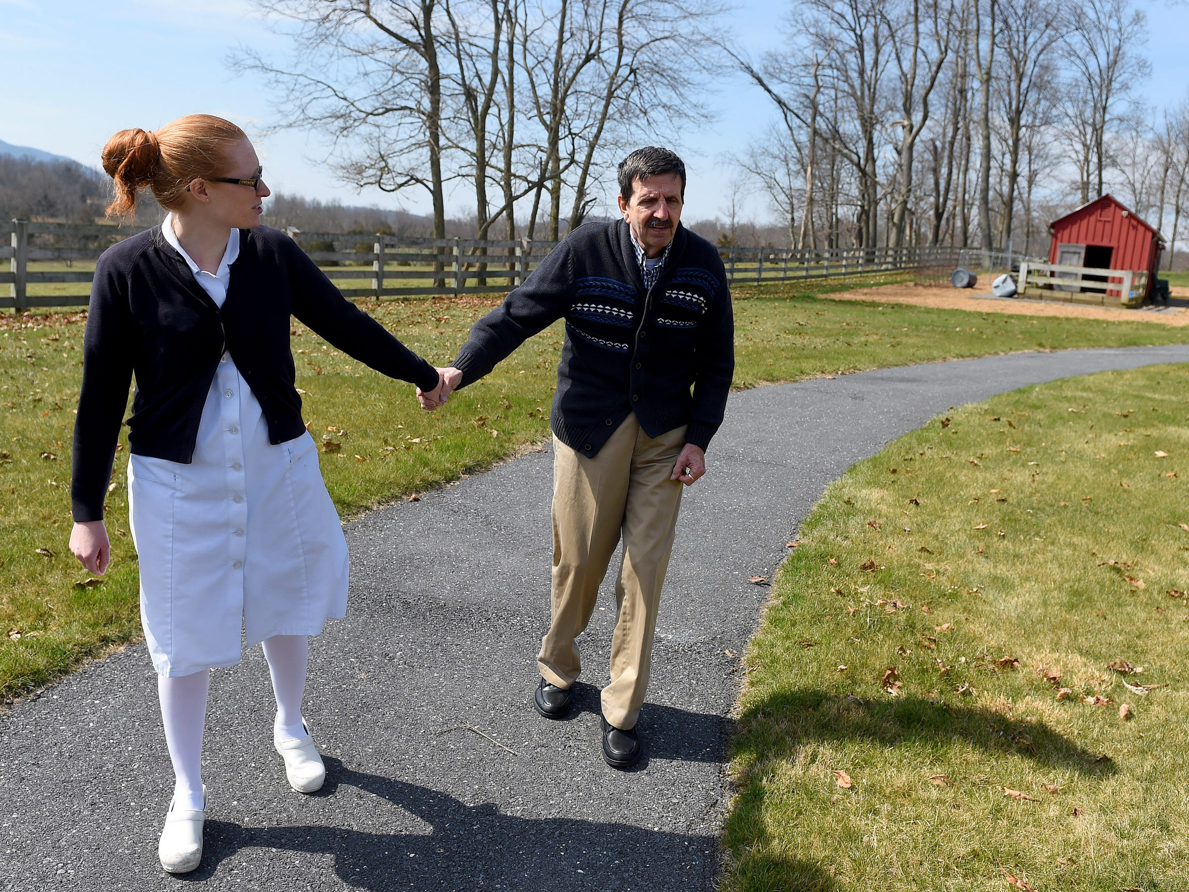 Tim Wood enjoys a walk outside. He walks with Sarah
