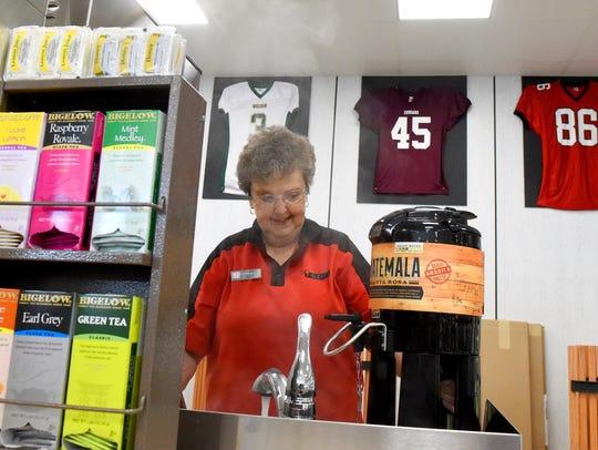 Steam rises as Barbara Swortzel of 7-Eleven in Fishersville