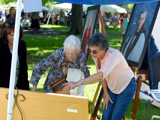 Artist Nahid Neff discusses her work with 94-year-old Rosemary Hall who is very interested in the artist's style. The Staunton Augusta Art Center presented its 49th annual Art in the Park at Gypsy Hill Park on May 23, 2015.