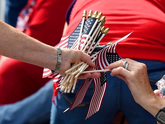 Flags are handed out during the parade to those along the parade route. America's Birthday Celebration held its annual parade in Gypsy Hill Park on Saturday, July 4, 2015.