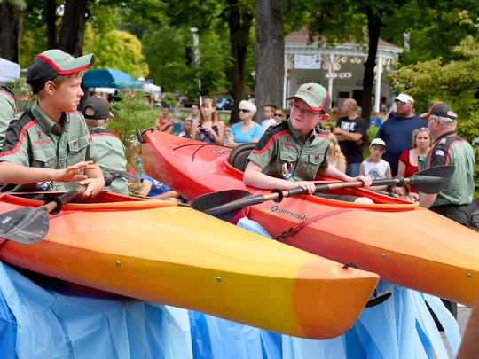 Scouts with Troop VA-22 of Trail Life USA ride in kayaks side-by-side on a float in the parade. America's Birthday Celebration held its annual parade in Gypsy Hill Park on Saturday, July 4, 2015.