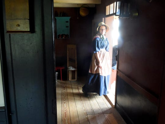 Reporter Megan William heads towards the front door
