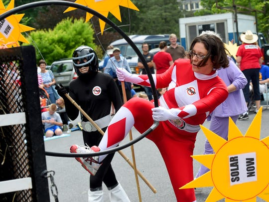 Ladies dressed as Power Rangers pretend to attack a pipeline in the parade. America's Birthday Celebration held its annual parade in Gypsy Hill Park on Saturday, July 4, 2015.