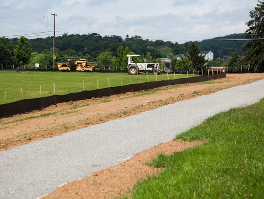 Gravel is laid down as part of construction at McSwain