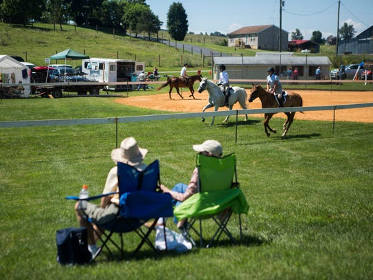 Spectators watch riders warm up during the 58th annual Middlebrook Horse Show in 2015.