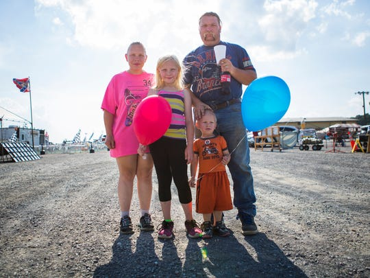 Nioka Breeden, left, and Darrell Breeden, right, of Buffalo Gap, pose with their two children, Skylar Breeden, 8, center left, and Zackarie Breeden, 2, at the Augusta County Fair on Tuesday, August 4, 2015.