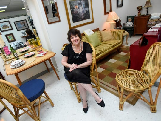 Vivian Myers, owner of VivianÕs, sits within her business