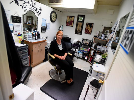Morene Hewitt, owner of MorreneÕs Hair Salon, sits in the salon chair in her business located inside VivianÕs at Terry Court Shopping Center on Thursday, August 6, 2015.
