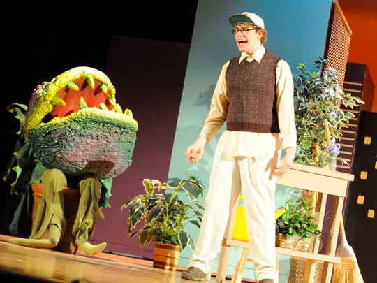 """Andrew Fauber portays Seymour as he speaks with the plant, Audrey II, during a dress rehearsal of """"Little Shop of Horrors"""" while a student at Wilson Memorial High school in March 2010."""