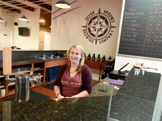 Owner Melissa Allen is photographed behind the bar at Seven Arrows Brewing Company in Waynesboro on Thursday, Dec. 18, 2014.