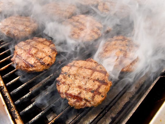 Burgers cook in the grill in the kitchen at DAP'S Ice Cream, Burgers and Fries in Stuarts Draft on Thursday, Sept. 3, 2015.  The restaurant is named after it's three owners — David Frazier, Audrey Frazier and Phil Witry.