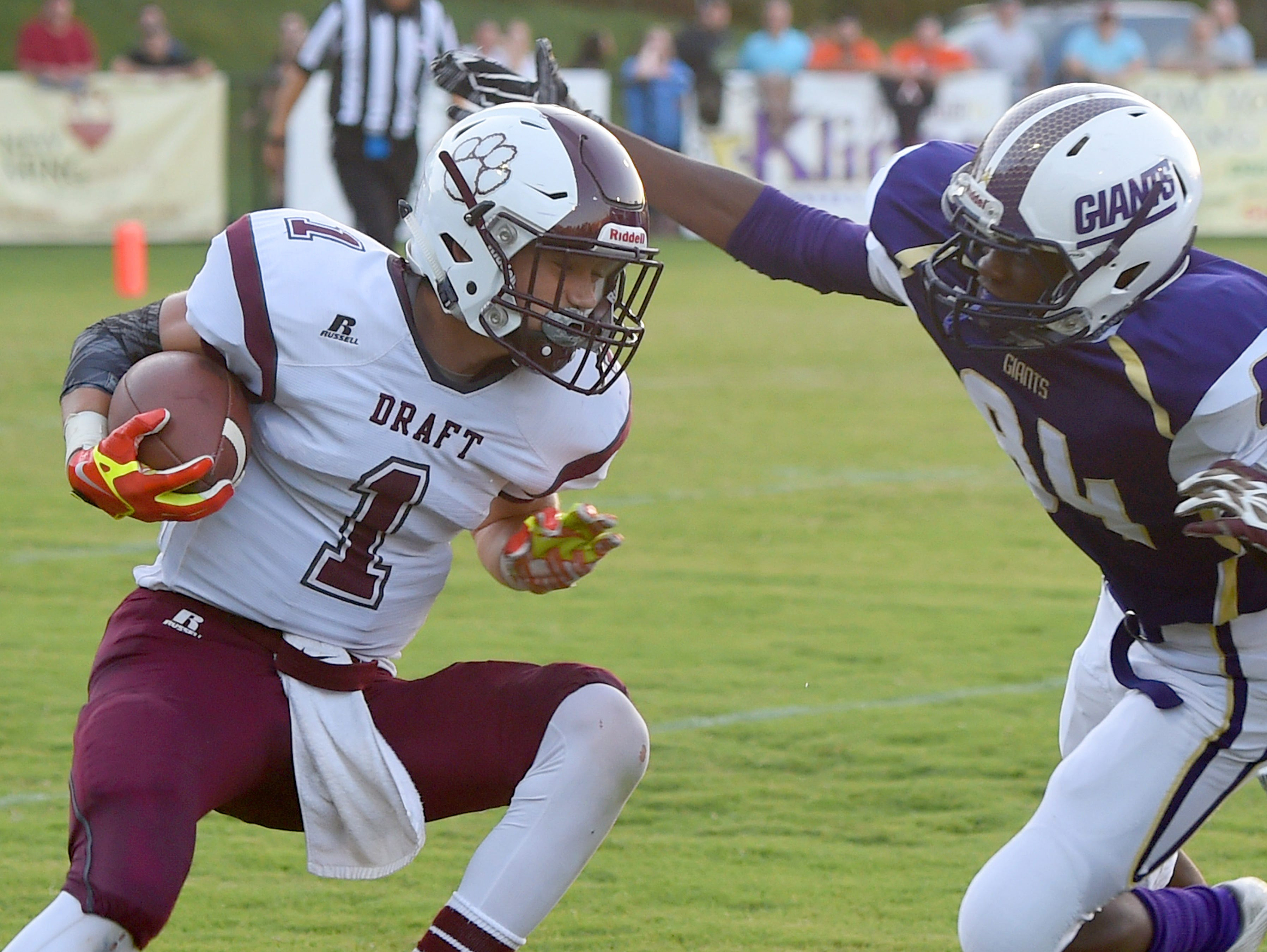 Stuarts Draft's Carson Peck has the ball as Waynesboro's Daviante Weems goes for a tackle during a football game played in Waynesboro on Friday, Sept. 11, 2015.