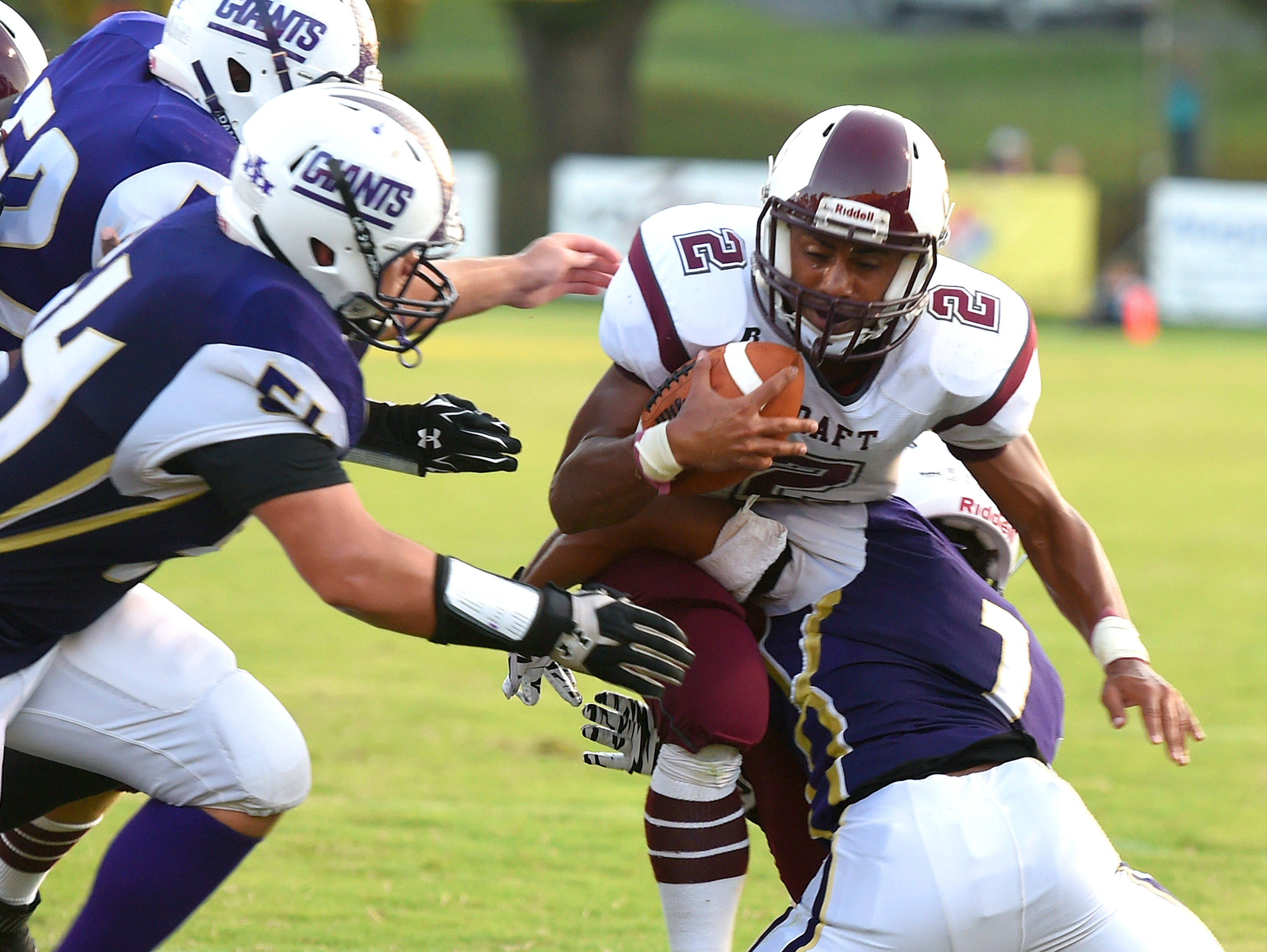 Stuarts Draft's Marston Jones is wrapped up by Waynesboro's Marendon Armon Jones as a pack of Waynesboro defenders close in during a football game played in Waynesboro on Friday, Sept. 11, 2015.