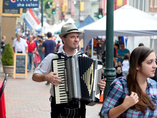 Orville Bame of Staunton plays the accordion as he