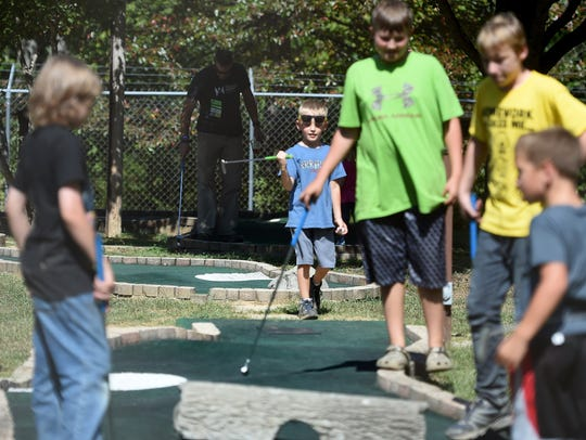 People play games of putt putt at the Good Times Festival