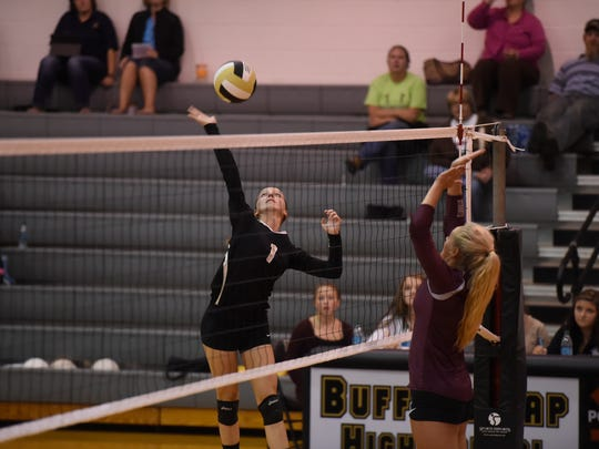 Buffalo Gap's Kieland Chandler makes a return against Stuarts Draft during their volleyball game on Tuesday, Sept. 22, 2015.