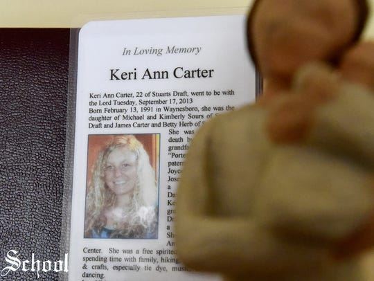 Kim Sours keep a laminated copy of daughter Keri Carter's