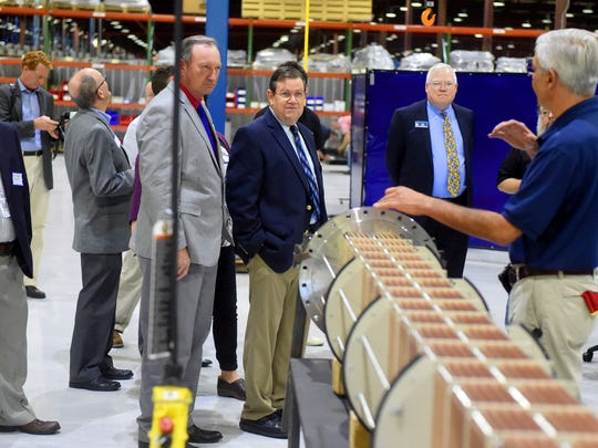 Those gathered listen as production supervisor Robert Henson with Provides US Inc. talks about the evaporators the company manufactures during a tour of their facility as part of an open house in Verona on Tuesday, Oct. 6, 2015.