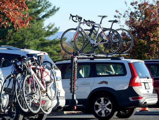 Cars are loaded down with bicyclists as participants