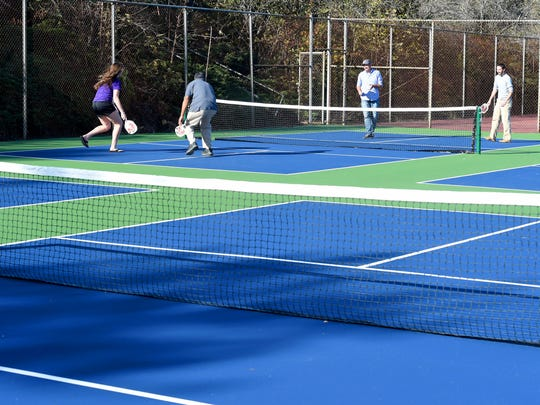 Four members of the Staunton Parks and Recreation staff play a game of pickleball together on the new pickleball courts at Montgomery Hall Park on Wednesday, Oct. 21, 2015.