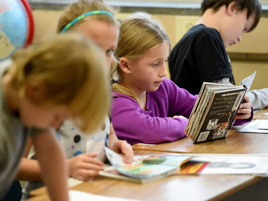 Third-grader Tehya Mills readers during third grade