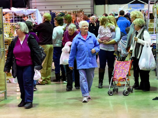 People browse the various vendors at the Fall Art and