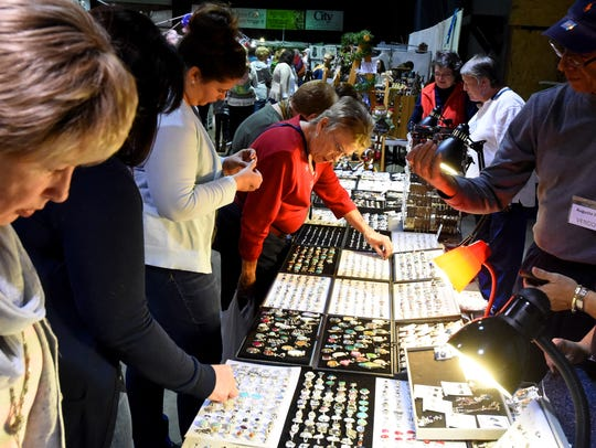 People browse jewelry for sell at one of the vendor