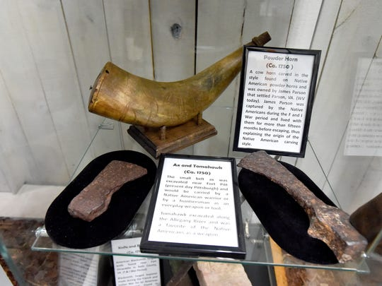 "Ax and tomahawks (Ca. 1750) and powder horn (Ca. 1750) on display in ""The Story of Virginia"" museum, located inside Wilderness Adventure in Staunton."