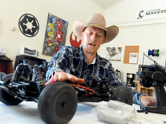 Local inventor Josh Lotts talks about the RC car racing and the 'ZRO trigger' he invented to be used with certain RC vehicle controllers during an interview at Staunton Makerspace on Wednesday, Dec. 9, 2015.