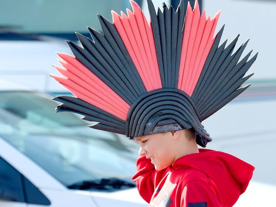 Jacob Kimble, 10, wears a gladiators hat as he walks towards the gates of Salem Stadium to watch Riverheads High School face-off against Galax High School in the Group 1A football championship in Salem on Saturday, Dec. 12, 2015.