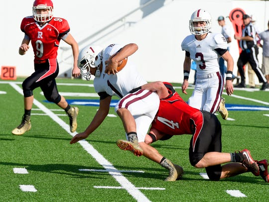 Galax's  Terrell Hundley is brought down by Riverheads'