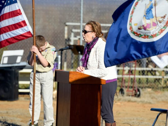 Retired teacher Donna Lewis leads the students and those gathered in prayer as she delivers the invocation at a groundbreaking ceremony for the school's new building at Hugh K. Cassell Elementary School on Wednesday, Dec. 16, 2015.
